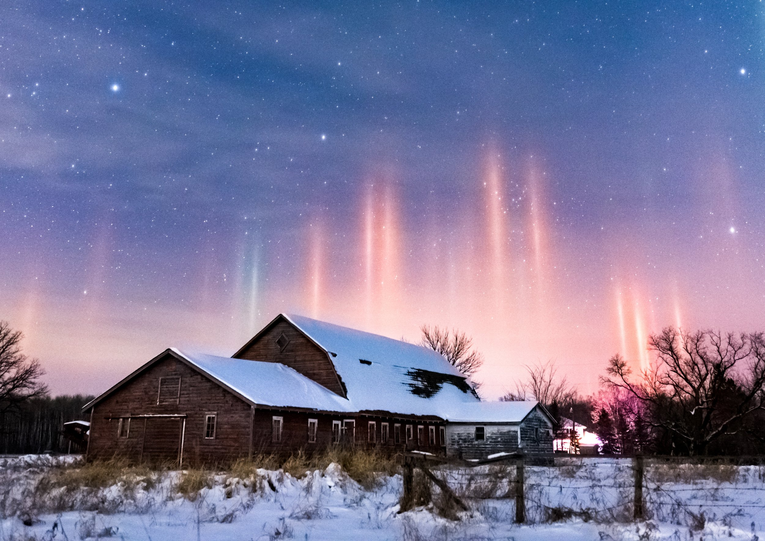 Picture supplied by Brent Mckean/Bav Media 07976 880732. Standalone picture shows the unusual atmospheric optical phenomenon of Light Pillars in Eastern Manitoba, Canada on Sunday evening (Dec 30th). A photographer has taken extraordinary pictures of rare LIGHT PILLARS extending into the night sky after sunset. Brent Mckean took the unusual photos of the atmospheric optical phenomenon in Eastern Manitoba, Canada in sub zero temperatures on Sunday evening (Dec30). Light pillars are created by the reflection of light from millions of tiny ice crystals suspended in the atmosphere. They form a vertical band of light which appears to extend above a light source - in this case the lights from buildings.