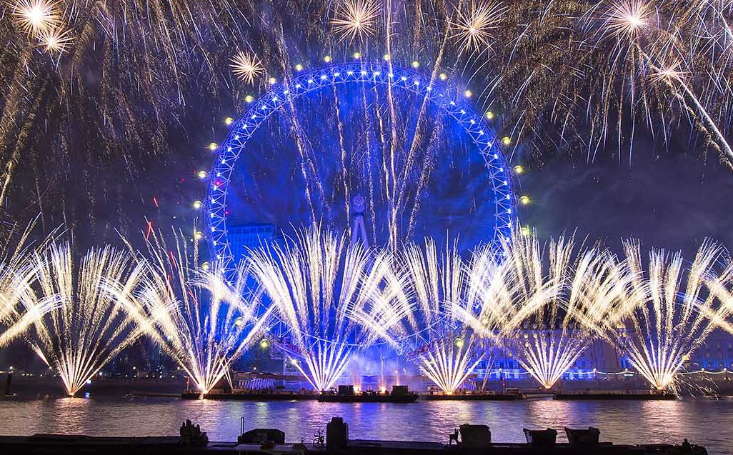 London?s New Year?s Eve fireworks celebrate the capital?s relationship with Europe, from the RAF Memorial on the Embankment looking across the River Thames towards the London Eye., London, Great Britain 31st December 2018 London?s world-famous New Year?s Eve fireworks will tonight welcome in 2019 with a celebration of the capital?s relationship with Europe and soundtrack inspired by the continent. As part of the Mayor?s #LondonIsOpen campaign, the fireworks will show the world that London is proud to be a global, European city and send a message of support to the more than one million European citizens living in London. The spectacular display, organised by the Mayor of London brings together more than 100,000 spectators. The show is the largest annual firework display in Europe, will include eight tonnes of fireworks connected to 5,000 firing circuits across 348 firing locations on barges, pontoons and the Coca-Cola London Eye. The celebration was started by the strikes of Big Ben, which has remained silent during the year while undergoing renovation works.