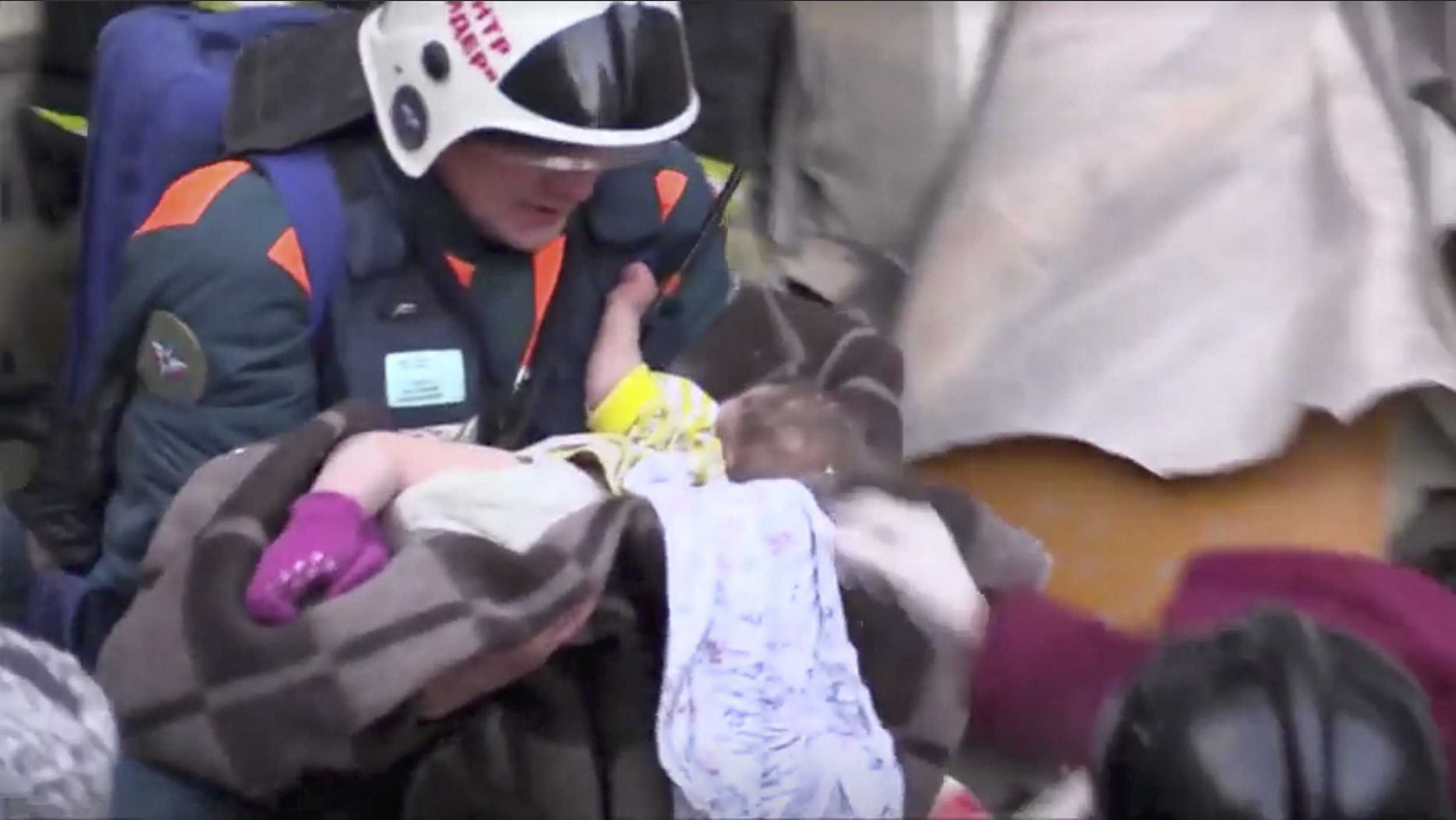 REFILE - CORRECTING AGE OF A CHILD A still image taken from a video footage showsaA rescuer carries a 11-month-old child found alive in the rubble of a Russian apartment block that partially collapsed after a suspected gas blast in Magnitogorsk, Russia January 1, 2019. Minister of Civil Defence, Emergencies and Disaster Relief/Handout via REUTERS TV ATTENTION EDITORS - THIS IMAGE WAS PROVIDED BY A THIRD PARTY. NO RESALES. NO ARCHIVES.