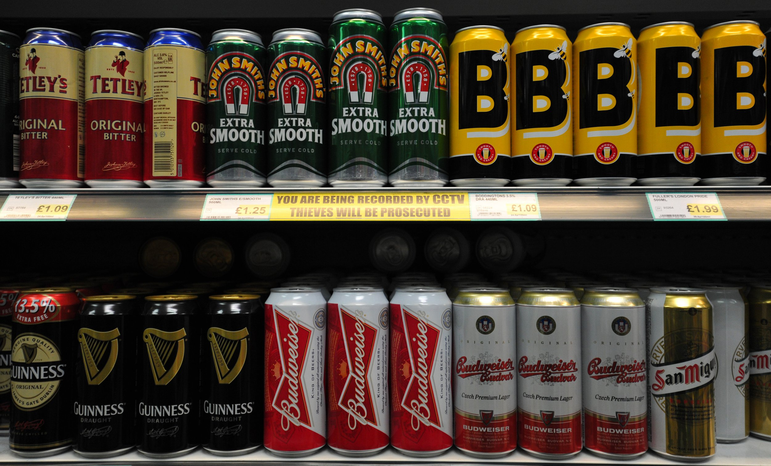 Cans of beer line a shelf in a store in central London on November 28, 2012. The British government was to announce plans on November 28 for a minimum alcohol price of 0.45 GBP (0.72 USD, 0.56 euros) in England and Wales in an attempt to restrain an infamous binge-drinking culture. AFP PHOTO / CARL COURT (Photo credit should read CARL COURT/AFP/Getty Images)