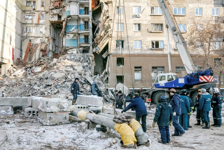 Russian Emergencies Ministry members work at the site of a partially collapsed apartment block in Magnitogorsk, Russia January 1, 2019. Picture taken January 1, 2019. REUTERS/Andrey Serebryakov