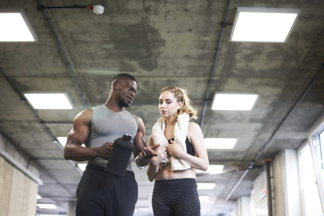 Two people talking after a workout at the gym