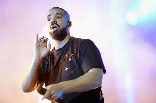 Drake performing on stage.