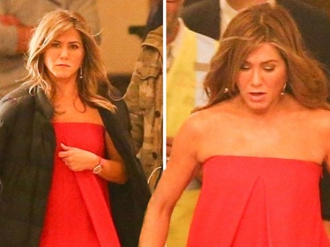 Jennifer Aniston fights the chill on set as lady in red amid Brad Pitt and Charlize Theron dating rumours