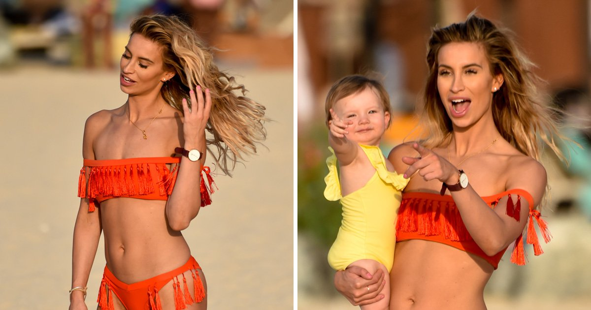 Ferne McCann poses up a storm looking stunning in a red bikini as baby Sunday could not care less