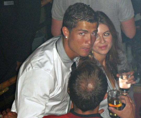 "In this June 2009 photo made available to the Associated Press on Friday Oct. 5, 2018, soccer star Cristiano Ronaldo is pictured with Kathryn Mayorga in Rain Nightclub in Las Vegas. A lawyer for Mayorga, who is alleging that Ronaldo raped her in Las Vegas in 2009 said her client was ""emotionally fragile"" and agreed to an out-of-court financial settlement nine years ago because then she never wanted her name made public. Mayorga filed a lawsuit last week in state court seeking to void the agreement she signed while accepting $375,000 to keep quiet about the alleged encounter. (Matrixpictures via AP) NO SALES NO ARCHIVE MANDATORY CREDIT"