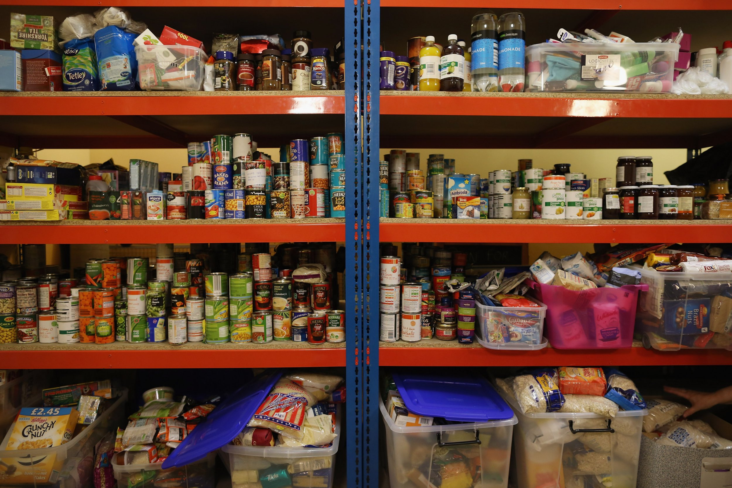LONDON, ENGLAND - OCTOBER 23: Food is stacked on shelving at a Food Bank depot at St. Paul's Church in Brixton on October 23, 2012 in London, England. The need for food banks has increased with around three depots opening across the UK each week. The Trussell Trust, the charity running food banks, have said that record numbers of people have required emergency food over the last six months and they expect to feed 200,000 over the next year. Vulnerable people of all ages, nationalities and backgrounds, many of whom have fallen out of the benefit system and have no other way to feed themselves and their families, are using food banks. (Photo by Dan Kitwood/Getty Images)