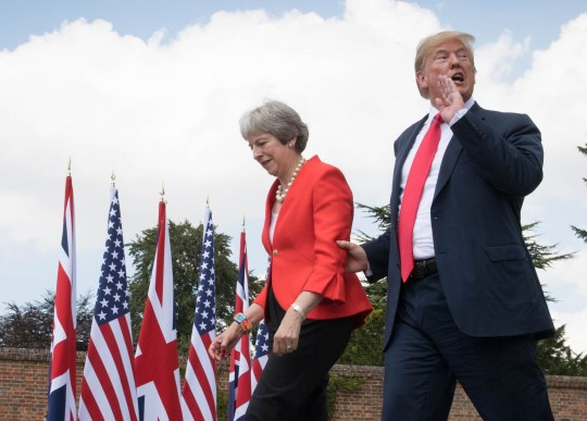 REVIEW OF THE YEAR PICS 2018 File photo dated 13/07/18 of US President Donald Trump walking with Prime Minister Theresa May prior to a joint press conference at Chequers, her country residence in Buckinghamshire. PRESS ASSOCIATION Photo. Issue date: Sunday December 16, 2018. See PA story XMAS Year. Photo credit should read: Stefan Rousseau/PA Wire