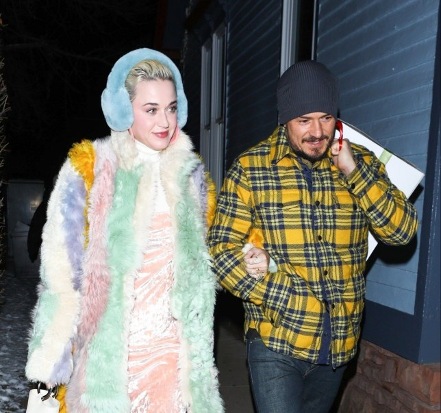 Aspen, CO - *EXCLUSIVE* - Katy Perry and Orlando Bloom are inseparable as are seen arriving to dinner in Aspen at Matsuhisa after ringing in the New Year with their celeb friends. The singer and actor look cozy as they arrive arm in arm to the sushi hotspot together. Katy keeps it cute in a multi-colored pastel fur coat, a peach velvet slip paired with white stockings and a pair of Filas sneakers. Pictured: Katy Perry, Orlando Bloom BACKGRID USA 3 JANUARY 2019 BYLINE MUST READ: NEMO / BACKGRID USA: +1 310 798 9111 / usasales@backgrid.com UK: +44 208 344 2007 / uksales@backgrid.com *UK Clients - Pictures Containing Children Please Pixelate Face Prior To Publication*