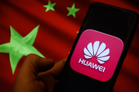 KRAKOW, POLAND - 2018/12/18: Huawei logo and China flag is seen on an android mobile phone. (Photo by Omar Marques/SOPA Images/LightRocket via Getty Images)