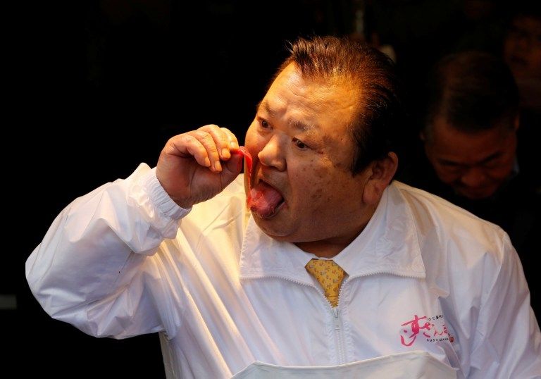 Kiyomura Co's President Kiyoshi Kimura, who runs a chain of sushi restaurants Sushi Zanmai, tastes meat from a 278kg bluefin tuna, priced with a 333,600,000 yen bid at the Toyosu fish market's first tuna auction this year, at his sushi restaurant in Tokyo, Japan, January 5, 2019. REUTERS/Kim Kyung-Hoon