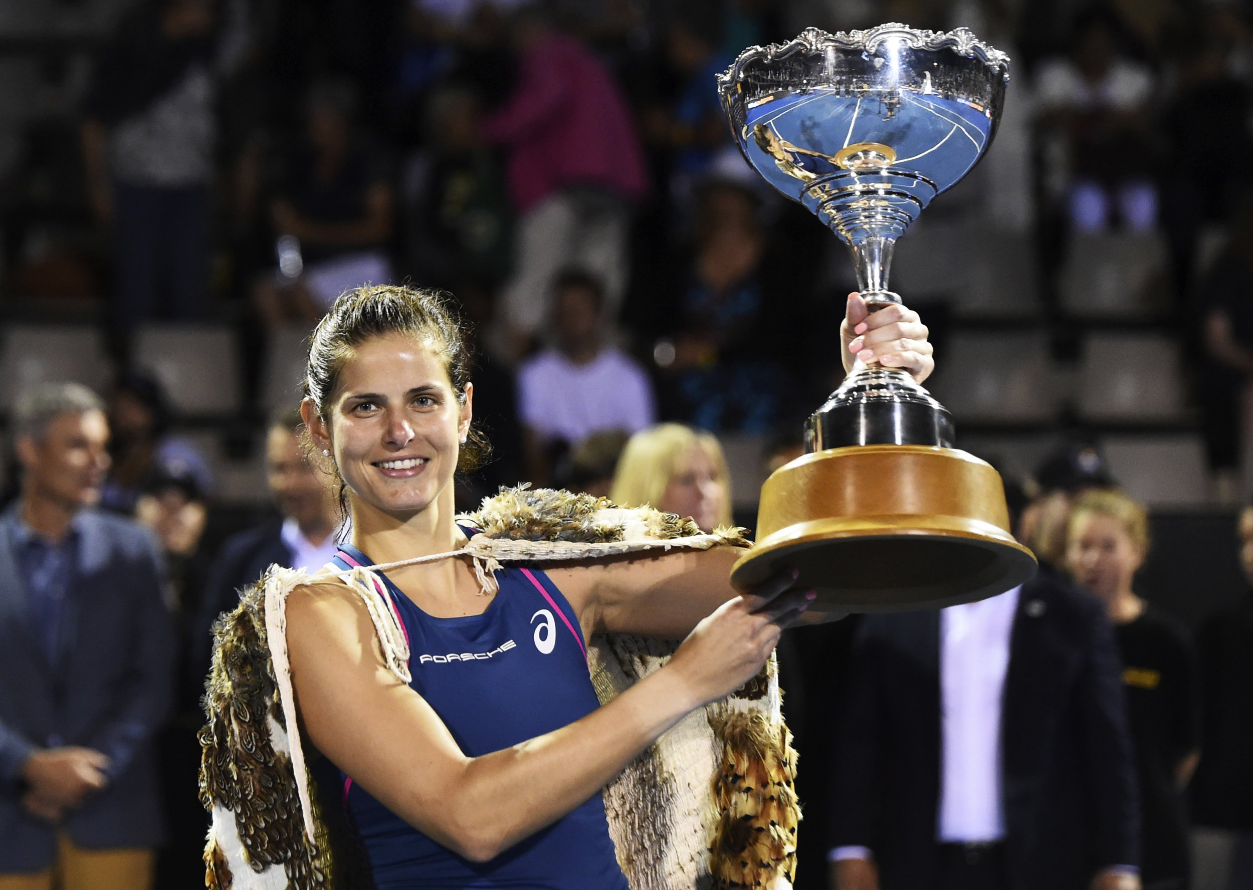 Germany's Julia Goerges holds the trophy after winning the singles final of the ASB Classic tennis tournament in Auckland, New Zealand, Sunday, Jan. 6, 2019. (AP Photo/Chris Symes)