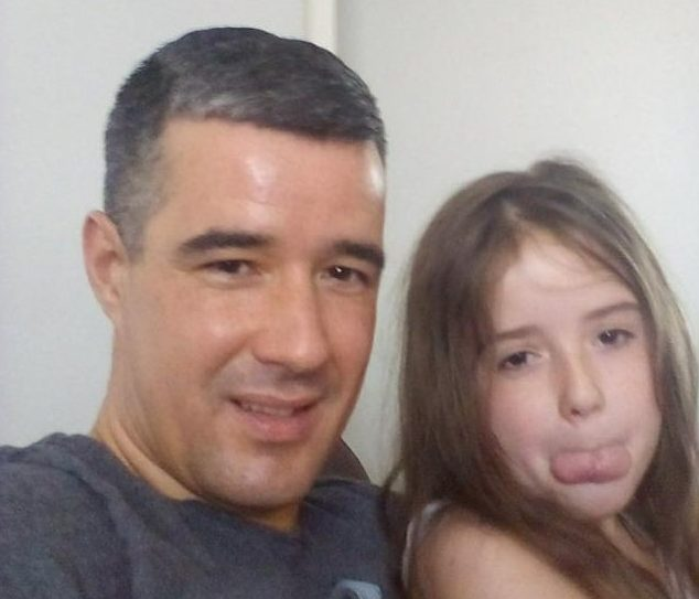 A single dad had his universal credit stopped because the DWP said 'he was in PRISON'. Lee Carroll, from Kirkdale, said he contacted the Department for Work and Pensions after he noticed his monthly payment had been suspended. Caption: Lee Carroll, pictured with his 10-year-old daughter had his universal credit stopped after the DWP falsely had him listed as he was in prison.