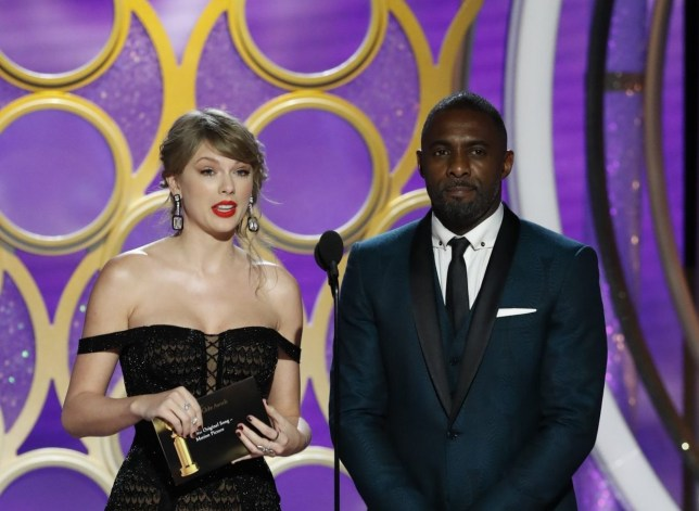 BEVERLY HILLS, CALIFORNIA - JANUARY 06: In this handout photo provided by NBCUniversal, Presenters Taylor Swift and Idris Elba speak onstage during the 76th Annual Golden Globe Awards at The Beverly Hilton Hotel on January 06, 2019 in Beverly Hills, California. (Photo by Paul Drinkwater/NBCUniversal via Getty Images)