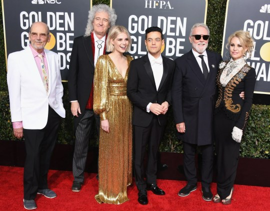 BEVERLY HILLS, CA - JANUARY 06: (L-R) Jim Beach, Brian May of Queen, Lucy Boynton, Rami Malek, Roger Taylor of Queen and Sarina Potgieter attend the 76th Annual Golden Globe Awards at The Beverly Hilton Hotel on January 6, 2019 in Beverly Hills, California. (Photo by Jon Kopaloff/Getty Images)