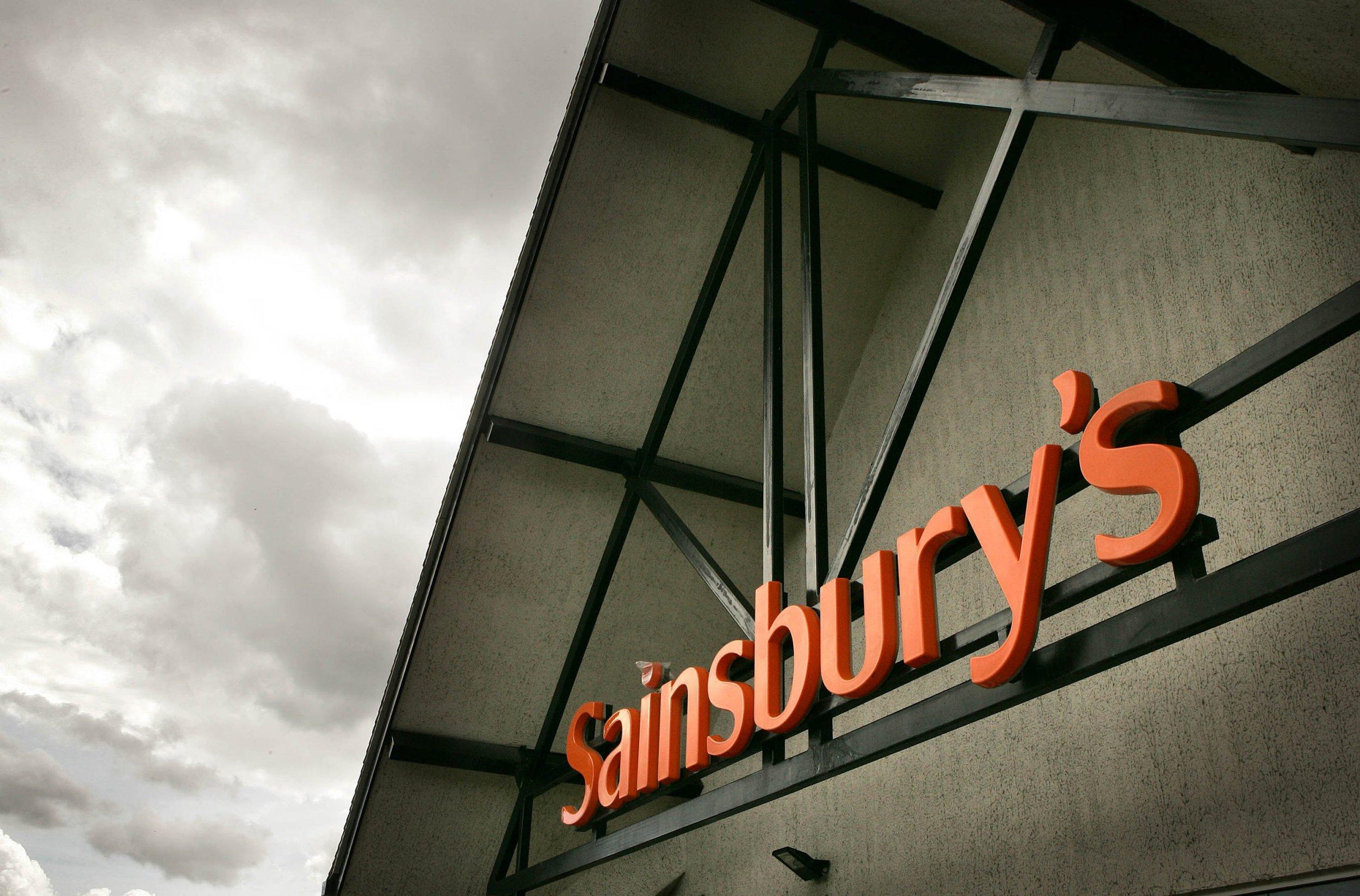the orange logo on a sainsbury's shop front
