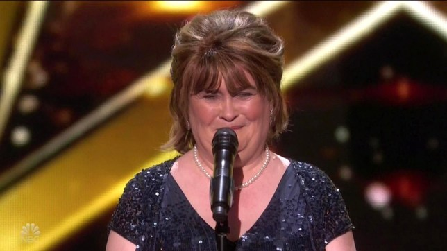 """BGUK_1451429 - ** RIGHTS: WORLDWIDE EXCEPT IN UNITED STATES ** Los Angeles, CA - Susan Boyle gets Golden Buzzer and advances straight to the finals as she appears on America's Got Talent: The Champions. The Scottish singer first wowed on Britain's Got Talent almost ten years ago - and she proved she's still got the talent to wow the judges when she appeared on the new show in the US - as she got the Golden Buzzer as the first through to the finals. The new spin-off show brought 50 of the top performers worldwide from the franchise's history, with Simon Cowell saying: """"It's like the Olympics: the best of the best. You're not just taking on America, you're taking on the world."""" Boyle was by far the most anticipated performer as the first 10 champions performed, getting rapturous applause and ovations as soon as she took the stage. Cowell looked genuinely moved to once again see the singer who became a worldwide viral phenomenon thanks to her performance of I Dreamed A Dream on Britain's Got Talent in 2009. """"And what's your name?"""" Simon smiled, telling her: """"Oh my God this brings back so many great memories having you back. Genuinely, I'm beyond thrilled that you're here tonight."""" The audience appeared enraptured during her ballad-style version of The Rolling Stones classic Wild Horses. """"I can't think of any other contestant who has defined this show better than you. You're the one. You made a huge difference to a lot of people's lives and I'm absolutely thrilled that you're here,"""" Cowell told her .Mel B added: """"I want to be the woman that gives you something that you deserve."""" The Spice Girls star then jumped up to press the Golden Buzzer sending her through, with Boyle looking stunned as gold confetti fell around her. Cowell followed Mel in running up onstage to hug her, telling Boyle as he pointed to the ovations: """"I'm so proud of you. You sounded amazing. Look at that."""" Boyle finally said she was 'very happy and very humble,' adding """"Thank you all very much."""" *BACK"""