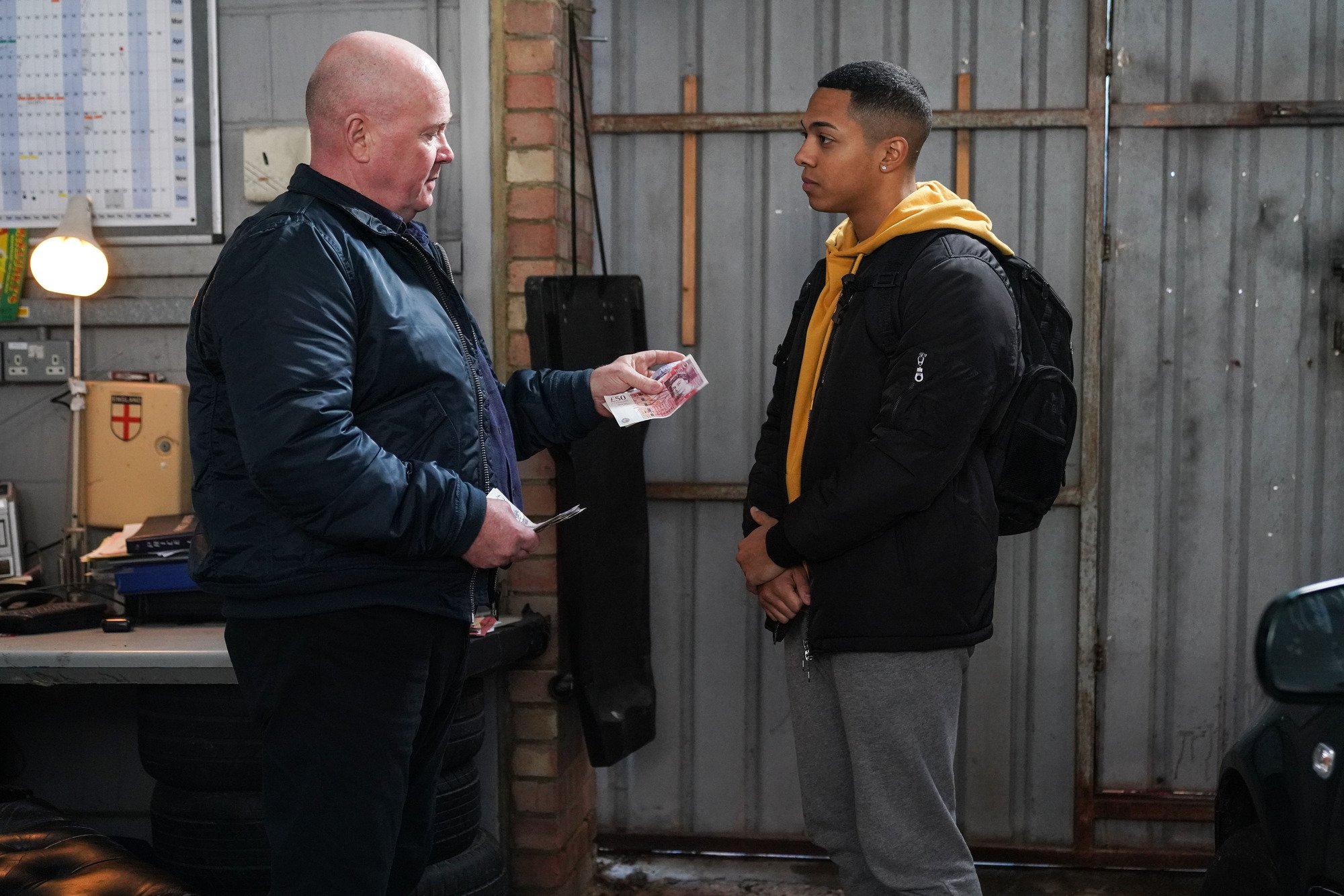 WARNING: Embargoed for publication until 00:00:01 on 15/01/2019 - Programme Name: EastEnders - January - March 2019 - TX: 24/01/2019 - Episode: EastEnders - January - March - 2019 - 5856 (No. n/a) - Picture Shows: *STRICTLY NOT FOR PUBLICATION UNTIL 00:01HRS TUESDAY 15th JANUARY 2019* Keegan strikes a deal with Phil Phil Mitchell (STEVE MCFADDEN), Keegan Baker (ZACK MORRIS) - (C) BBC - Photographer: Kieron McCarron