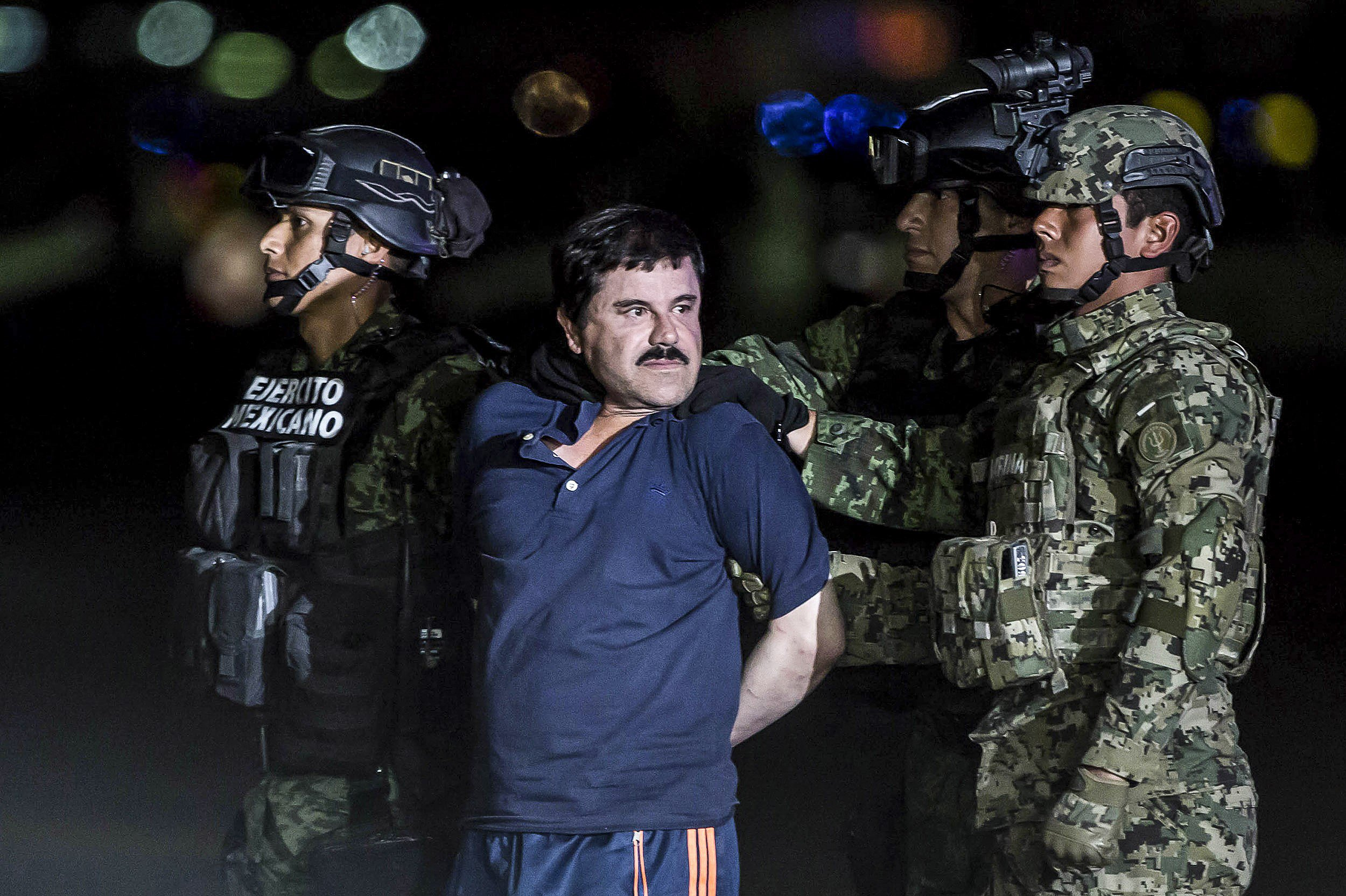 """MEXICO CITY, MEXICO - JANUARY 8: Joaquin Guzman Loera, also known as """"El Chapo"""" is transported to Maximum Security Prison of El Altiplano in Mexico City, Mexico on January 08, 2016. Guzman Loera, leader of Mexico's Sinaloa drug Cartel, was considered the Mexican most-wanted drug lord. Mexican marines captured """"El Chapo"""" on Friday in Sinaloa, North of Mexico. (Photo by Daniel Cardenas/Anadolu Agency/Getty Images)"""
