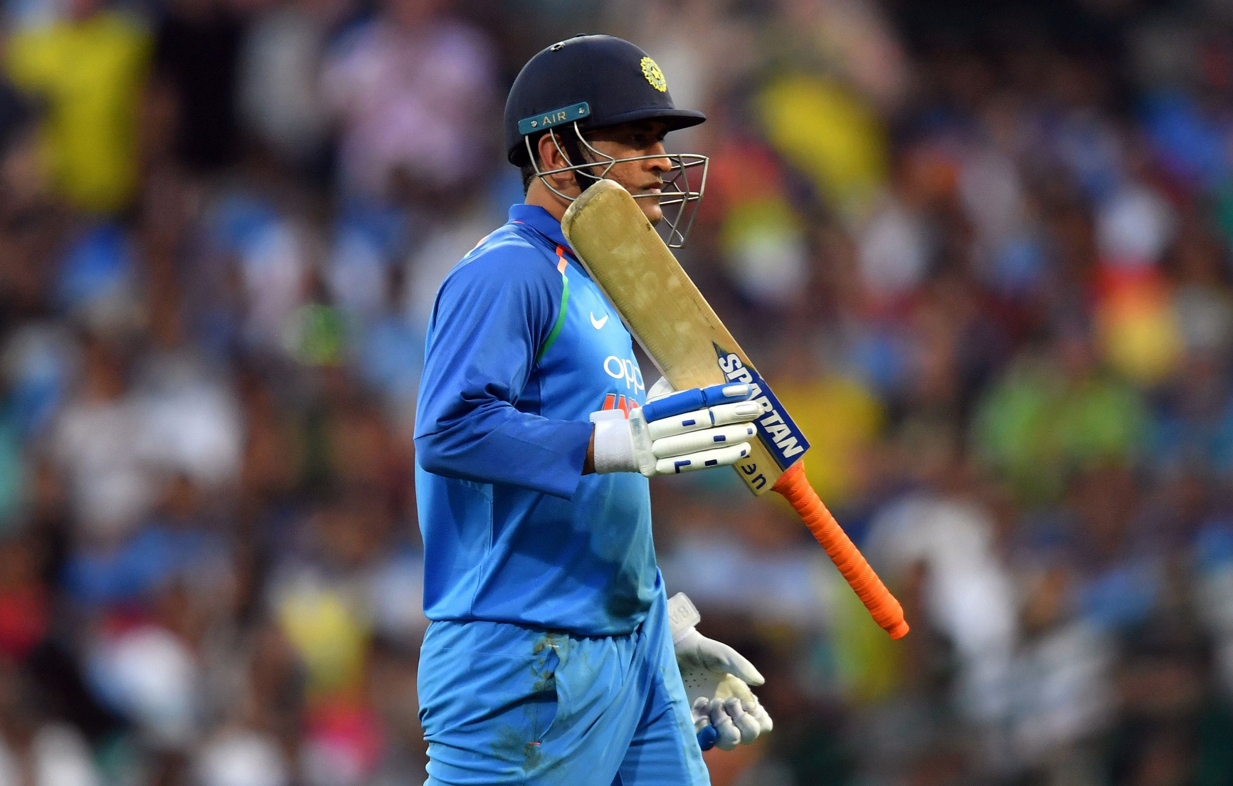 India's batsman Mahendra Singh Dhoni walks back to the pavilion after his dismissal during first one-day international (ODI) match between Australia and India at the Sydney Cricket Ground in Sydney on January 12, 2019. (Photo by Saeed Khan / AFP) / -- IMAGE RESTRICTED TO EDITORIAL USE - STRICTLY NO COMMERCIAL USE --SAEED KHAN/AFP/Getty Images