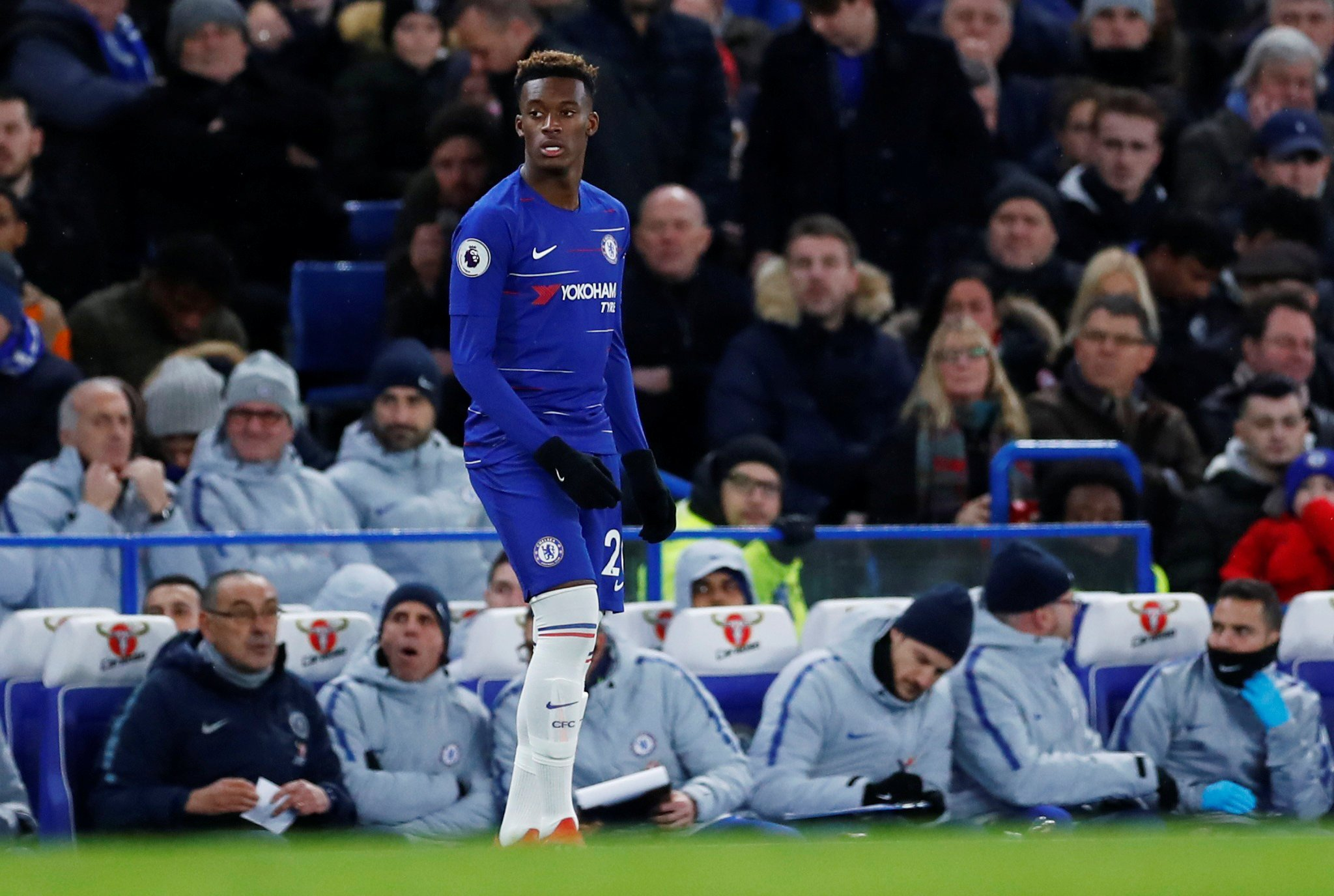 """Soccer Football - Premier League - Chelsea v Newcastle United - Stamford Bridge, London, Britain - January 12, 2019 Chelsea's Callum Hudson-Odoi reacts as manager Maurizio Sarri looks on REUTERS/Eddie Keogh EDITORIAL USE ONLY. No use with unauthorized audio, video, data, fixture lists, club/league logos or """"live"""" services. Online in-match use limited to 75 images, no video emulation. No use in betting, games or single club/league/player publications. Please contact your account representative for further details."""