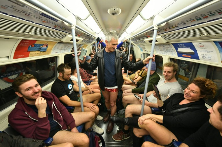 People on the Underground as they take part in the No Trousers Tube Ride, in London. PRESS ASSOCIATION Photo. Picture date: Sunday January 13, 2019. See PA story SOCIAL Pants. Photo credit should read: Dominic Lipinski/PA Wire