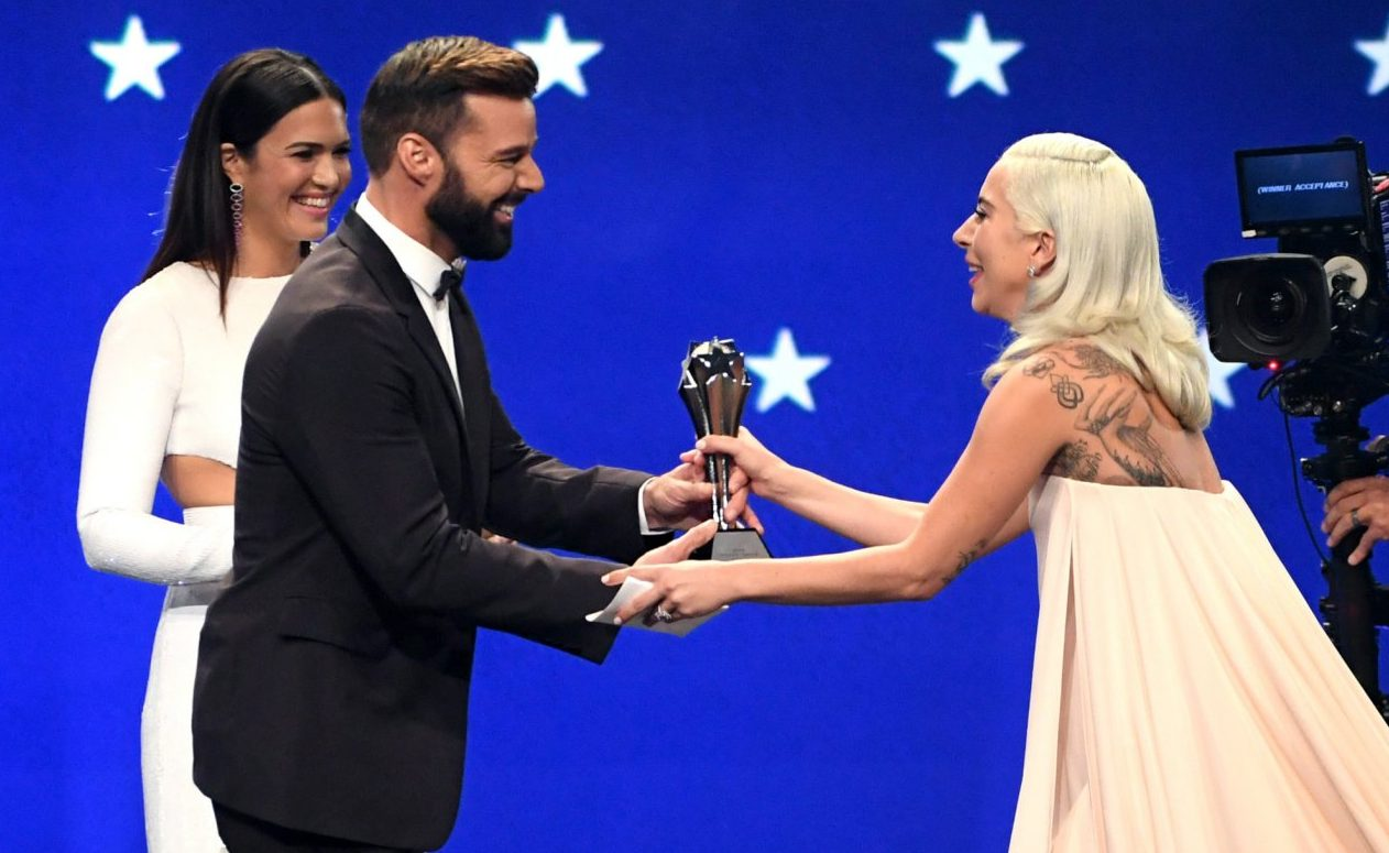 SANTA MONICA, CA - JANUARY 13: (L-R) Mandy Moore and Ricky Martin present the Best Song award for 'Shallow' from 'A Star Is Born' to Lady Gaga onstage during the 24th annual Critics' Choice Awards at Barker Hangar on January 13, 2019 in Santa Monica, California. (Photo by Kevin Winter/Getty Images for The Critics' Choice Awards)
