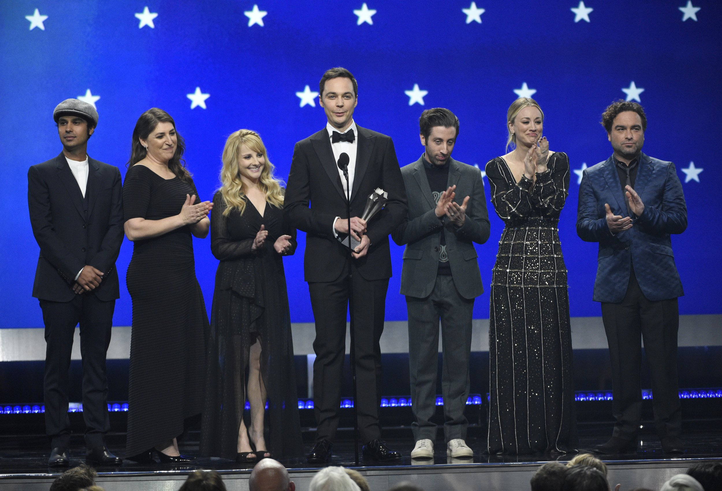 "Kunal Nayyar, from left, Mayim Bialik, Melissa Rauch, Jim Parsons, Simon Helberg, Kaley Cuoco and Johnny Galecki, from the cast of ""The Big Bang Theory,"" present the creative achievement award at the 24th annual Critics' Choice Awards on Sunday, Jan. 13, 2019, at the Barker Hangar in Santa Monica, Calif. (Photo by Chris Pizzello/Invision/AP)"