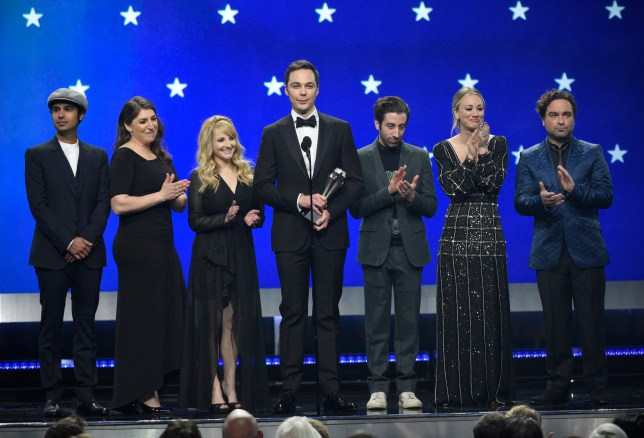 """Kunal Nayyar, from left, Mayim Bialik, Melissa Rauch, Jim Parsons, Simon Helberg, Kaley Cuoco and Johnny Galecki, from the cast of """"The Big Bang Theory,"""" present the creative achievement award at the 24th annual Critics' Choice Awards on Sunday, Jan. 13, 2019, at the Barker Hangar in Santa Monica, Calif. (Photo by Chris Pizzello/Invision/AP)"""