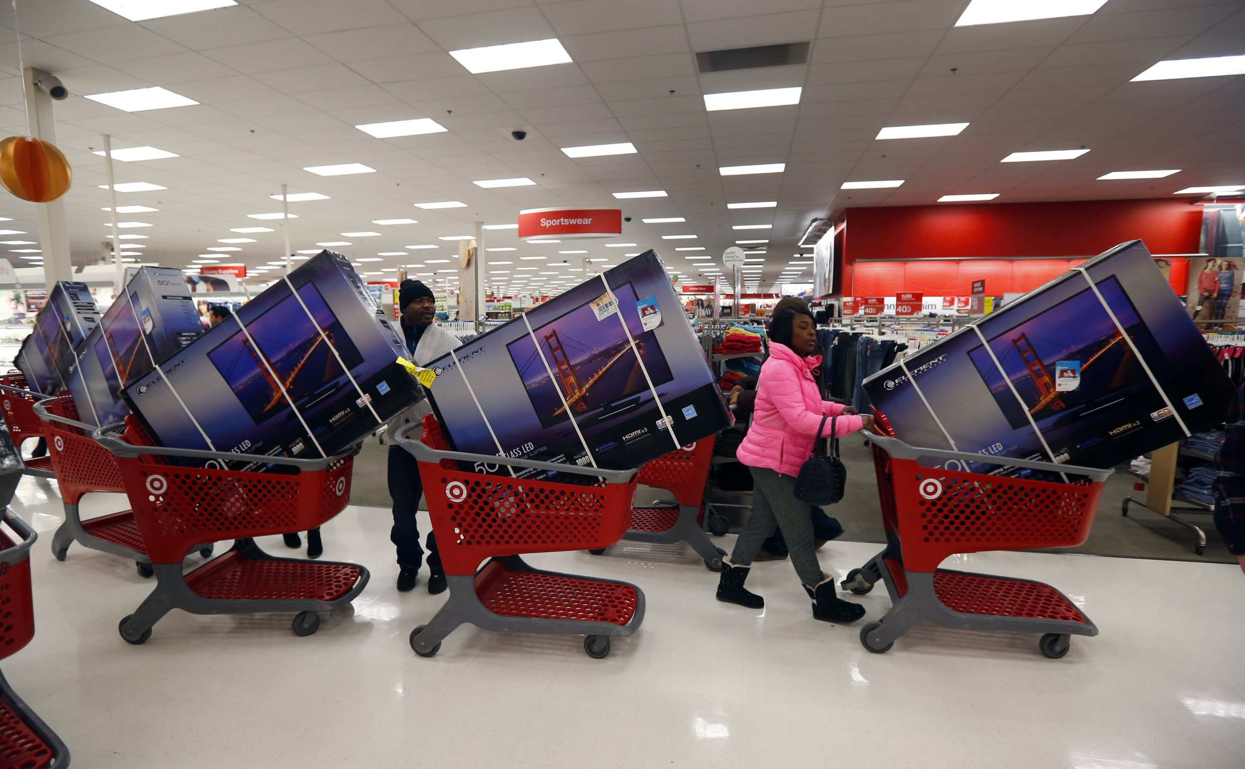 Thanksgiving Day holiday shoppers line up with television sets on discount at the Target retail store in Chicago, Illinois, November 28, 2013. About 140 million people are expected to shop over the four-day weekend, according to the National Retail Federation. REUTERS/Jeff Haynes (UNITED STATES - Tags: BUSINESS TPX IMAGES OF THE DAY) - GM1E9BT0TMK01