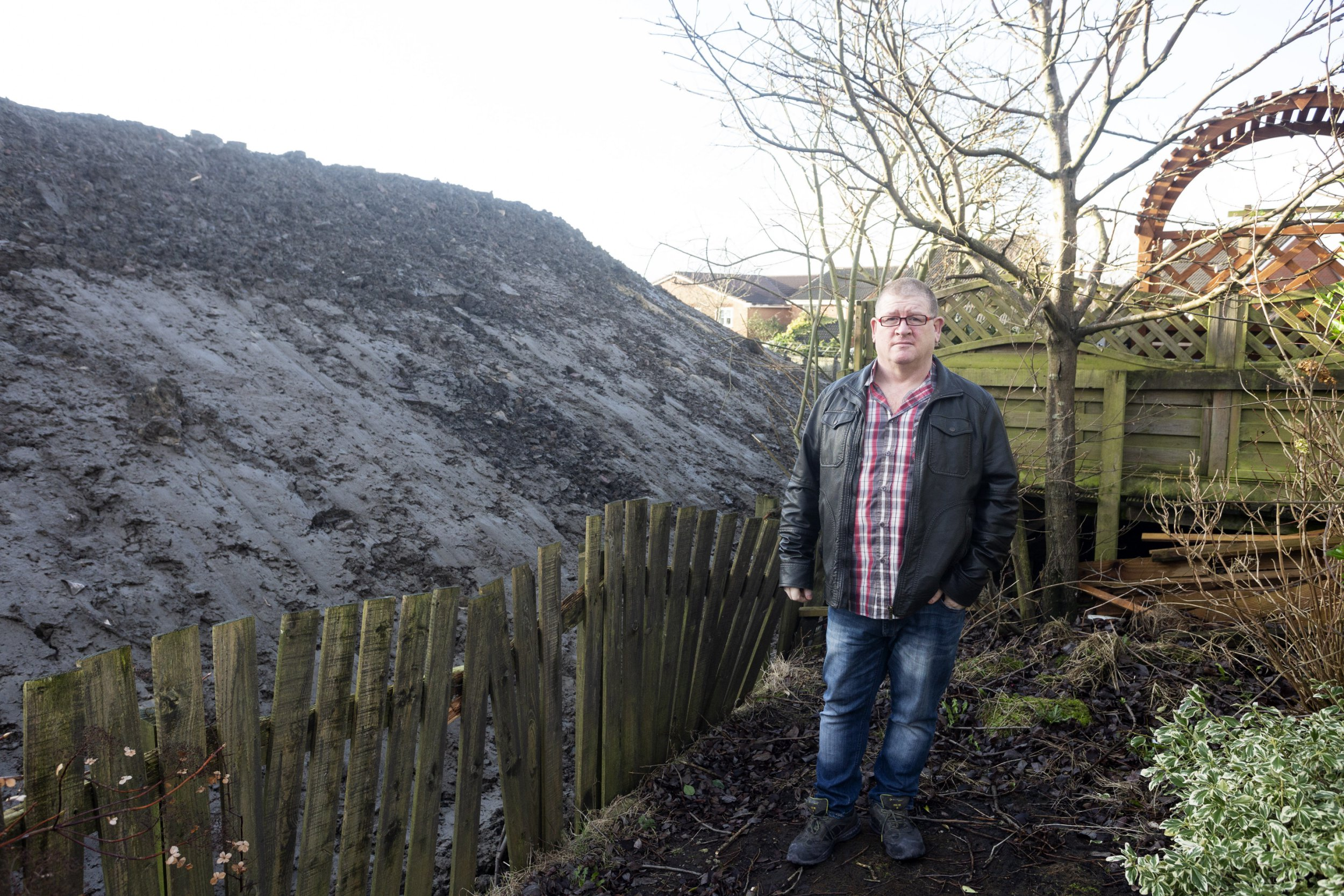 People compare huge mound dumped behind their homes to Donald Trump's wall