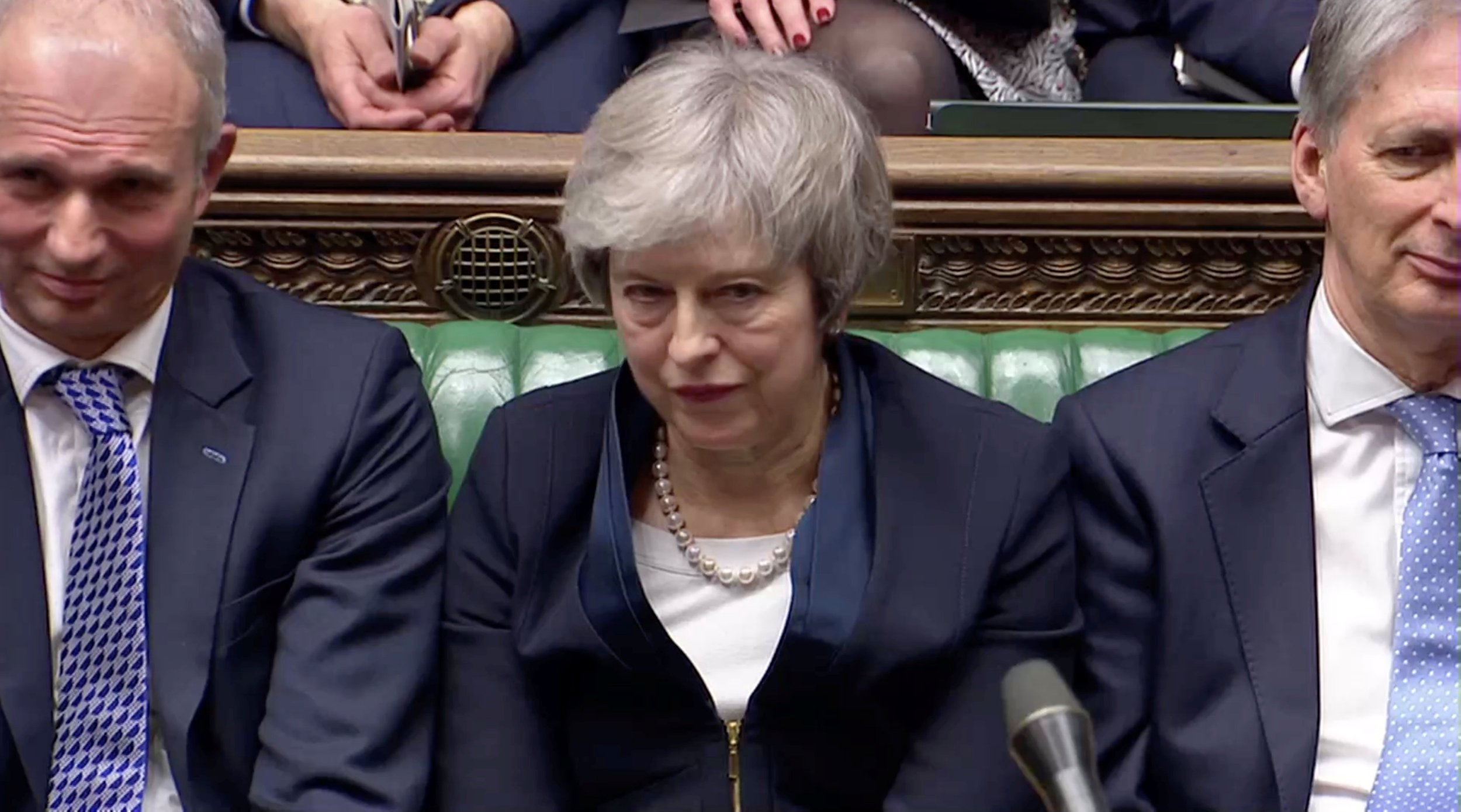 Prime Minister Theresa May sits down in Parliament after the vote on May's Brexit deal, in London, Britain, January 15, 2019 in this screengrab taken from video. Reuters TV via REUTERS
