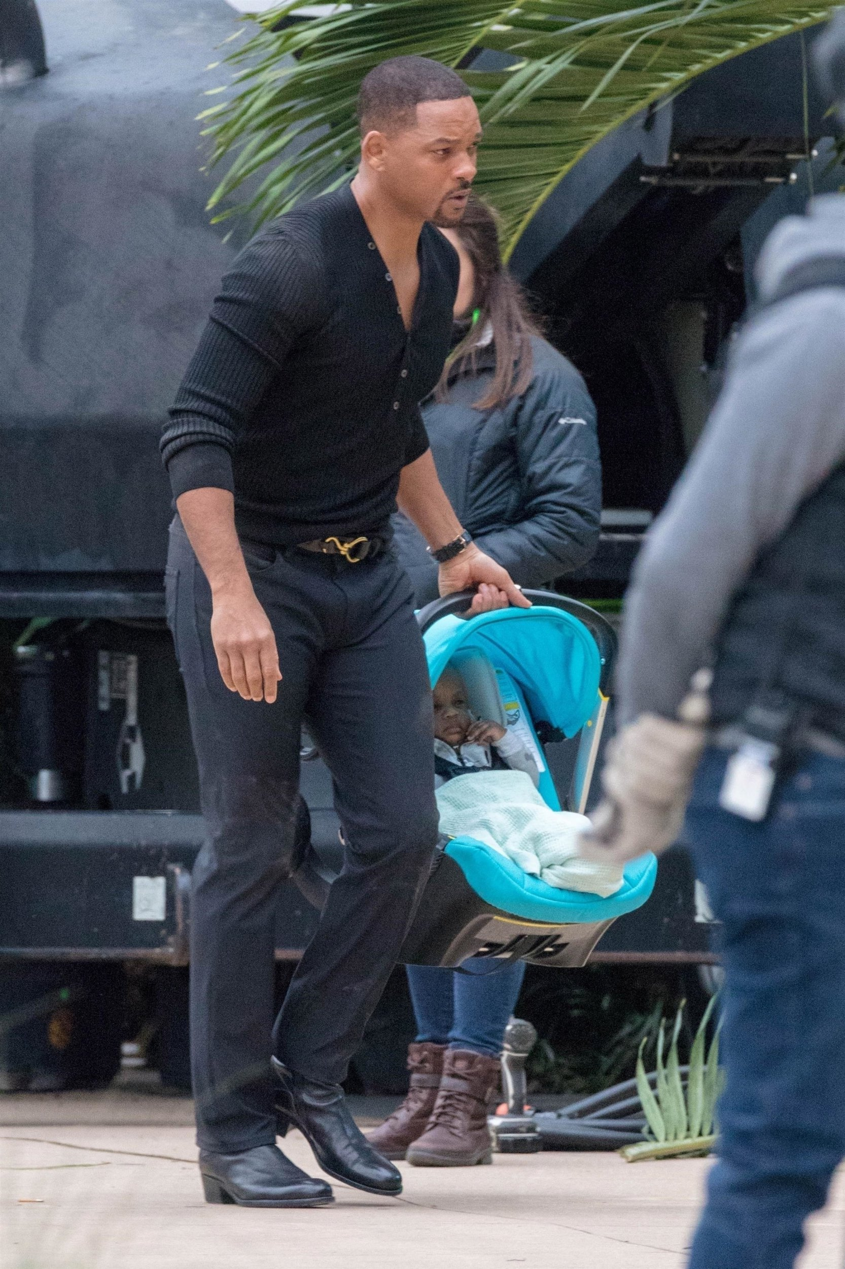 """Atlanta, GA - *EXCLUSIVE* Bad boy, Will Smith shows his sensitive side carrying a baby and his rugged side carrying a gun, on the set of """"Bad Boys for Life"""" filming in Atlanta. Smith and Martin Lawrence are reprising their roles as Miami cops Mike Lowry and Marcus Burnett for the third installment in the hit franchise which is due to hit theaters January 2020. *Shot on January 14, 2019* Pictured: Will Smith BACKGRID USA 16 JANUARY 2019 USA: +1 310 798 9111 / usasales@backgrid.com UK: +44 208 344 2007 / uksales@backgrid.com *UK Clients - Pictures Containing Children Please Pixelate Face Prior To Publication*"""
