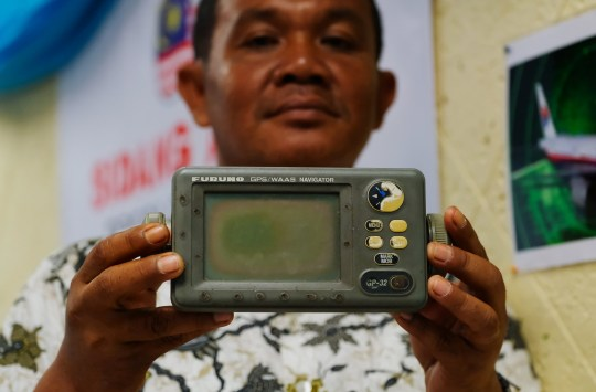 SUBANG JAYA, MALAYSIA - JANUARY 16 : Rusli Khusmin, 42, a fisherman from Indonesia shows his GPS Navigator which he used to record the co-ordinates of where he believes Malaysia Airlines Flight MH370 crashed into the Sumatra Indonesia Sea during a news conference on January 16, 2019 in Subang Jaya outside Kuala Lumpur, Malaysia. Rusli and his crew members, who claim that they were in the vicinity of the crash on the morning of March 8th, 2014, say that they witnessed a damaged aircraft, black smoke and the smell of acidic fumes before the aircraft crashed. CASSA Malaysia NGO, Dr Jacob George will officially send the evidence to Malaysia Prime Minister Mahathir Mohamad. According to local news reports, after years of attempts to find the crash site, the Malaysian government halted the investigation, having admitted that they did not know what had happened to the airplane. (Photo by Mohd Samsul Mohd Said/Getty Images)