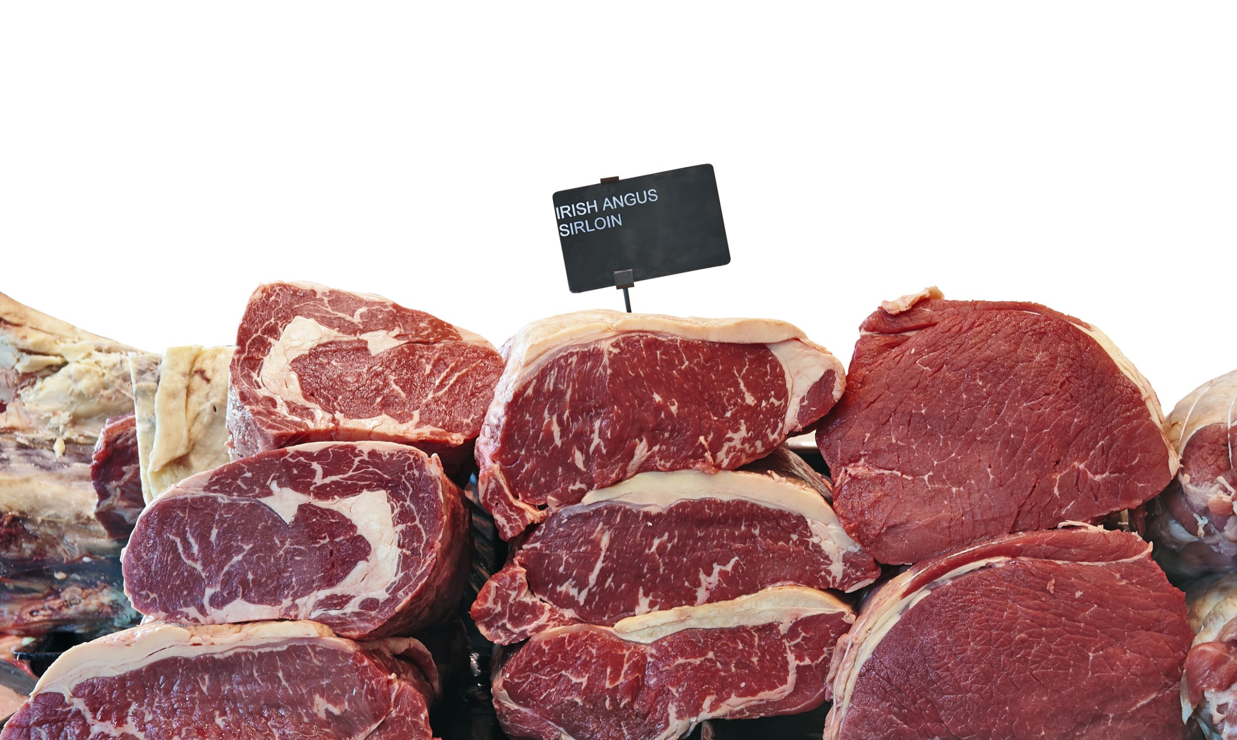 Fridge counter with variety of Irish angus beef meat isolated on white