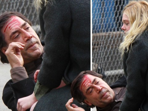 Javier Bardem is covered in blood as he films for Molly with Elle Fanning