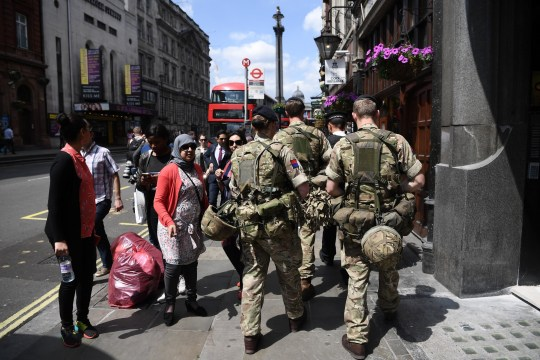 LONDON, ENGLAND - MAY 24: Armed soldiers walk up Whitehall towards Trafalgar Square on May 24, 2017 in London, England. 984 military personnel are being deployed around the country as the UK terror status is elevated to Critical in the wake of the Manchester Arena Terror Attack which took place on Monday night. Changing the Guard at the Buckingham Palace was cancelled and The Houses of Parliament have closed to the public. (Photo by Carl Court/Getty Images)