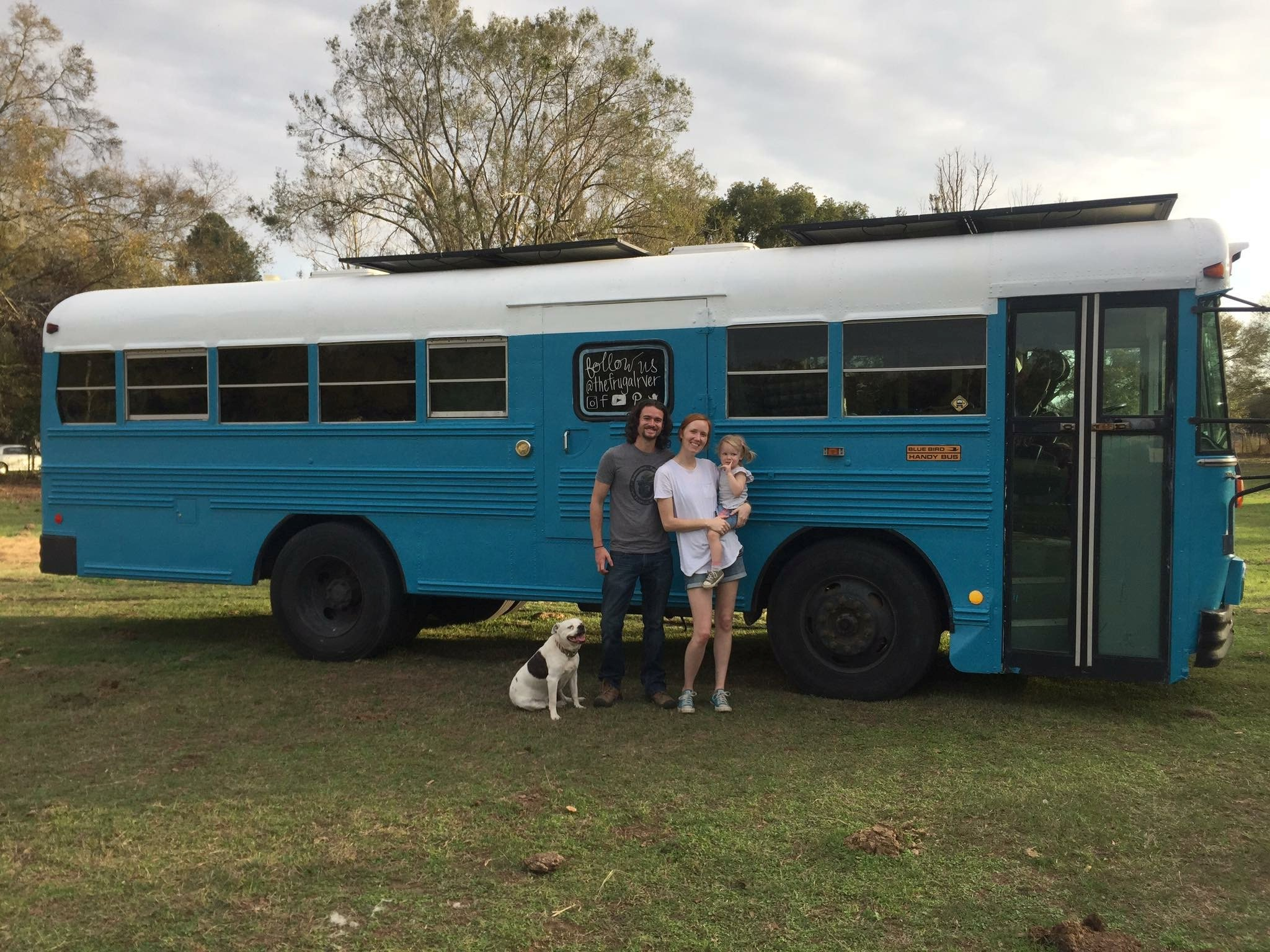 """Derek Cobia, Payton and Amy. See SWNS story BRNYbus; This family have dropped out of the rat race to live in an eco-friendly school bus. Derek Cobia, 33, and his wife Amy, 32, said their lives once revolved around mortgage payments and filling their four-bedroom home with things they ?didn?t need?. Now their days are spent on the open road - visiting 33 states in the last 18-months. """"Most of America is so glued to their phones, they don?t spend quality family time together,"""" said Derek. """"I never want to go back to our old lifestyle. It?s the greatest thing we have ever done in our relationship,"""" agreed Amy. The couple have invested $15,000 to renovate their bus with solar panels, a composting toilet and a bath tub big enough for two people. The 28ft by 8ft interior also contains a working kitchen, a wood-burning stove and fold up beds. The journey began in 2015 when they sold their house in Atlanta, Georgia, and moved to a local campsite with their daughter Payson, three, where they lived in a $65,000 RV for a year."""