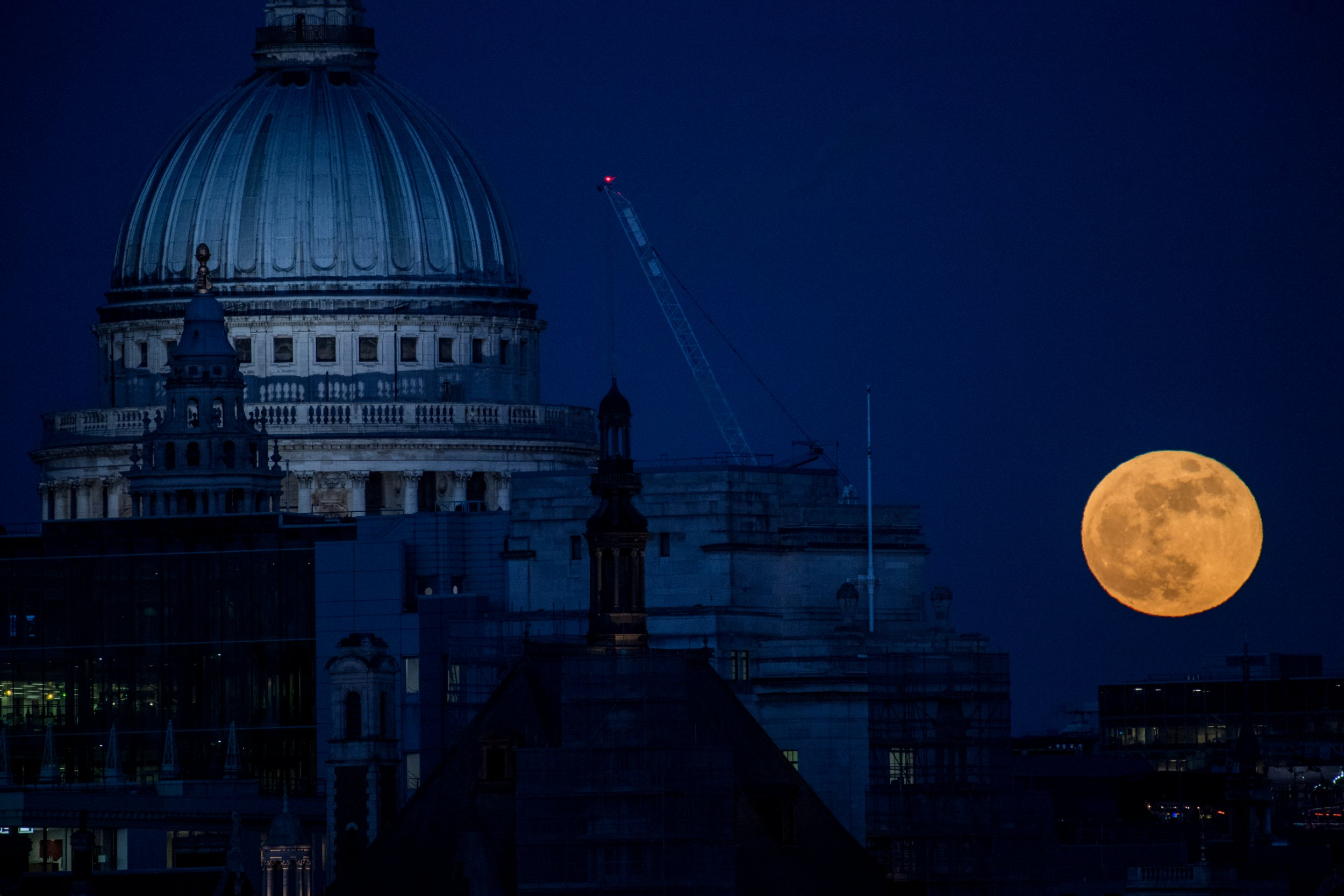 LONDON, UNITED KINGDOM - JANUARY 31: A supermoon rises behind St. Paul's Cathedral on January 31, 2018 in London, United Kingdom. The super blue blood moon is a rare combination of a supermoon, a blood moon and a blue moon all simultaneously occuring. (Photo by Chris J Ratcliffe/Getty Images)