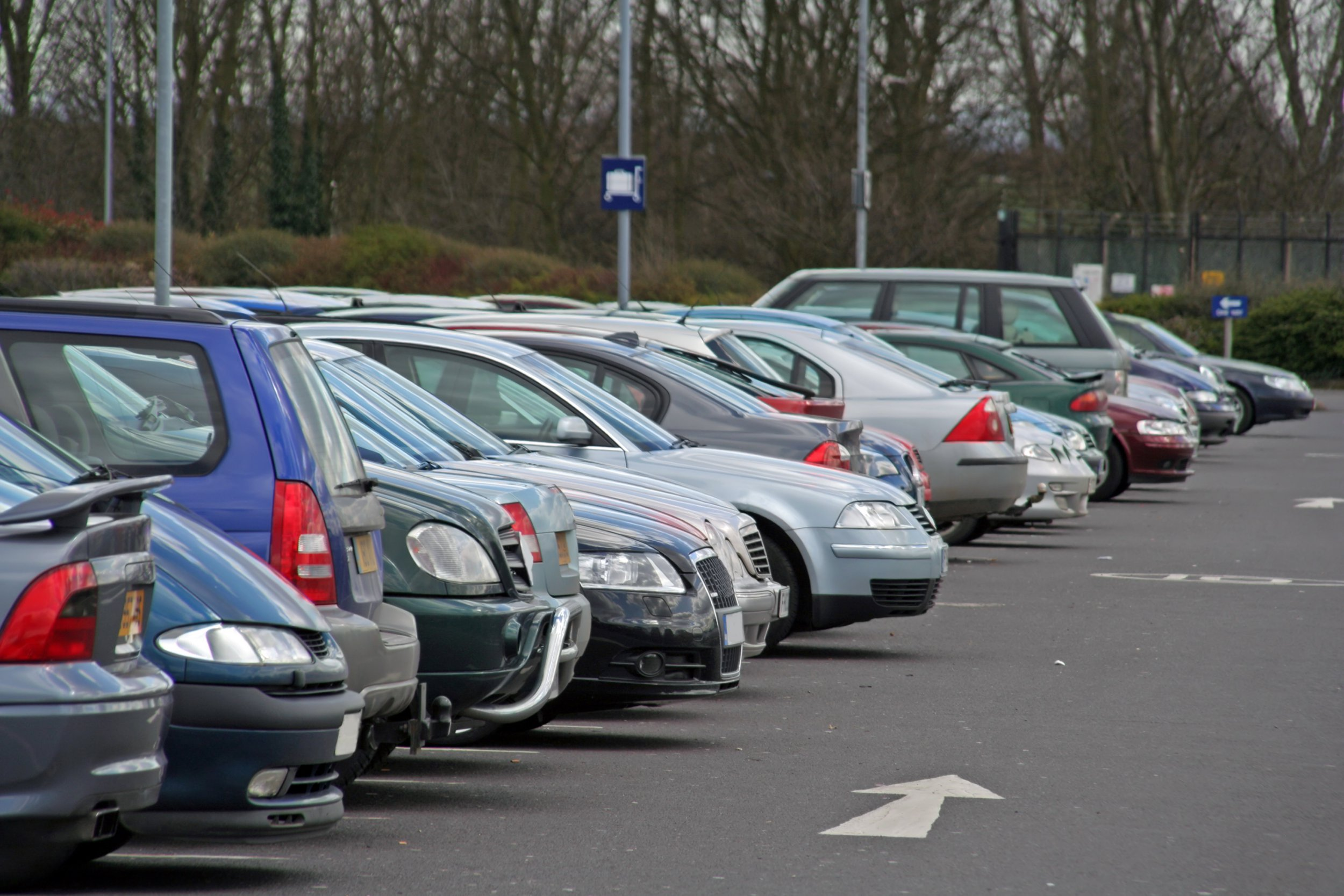 Commuters face paying ?1,000 to drive to work Car park in winter. Other pics of parked cars include...