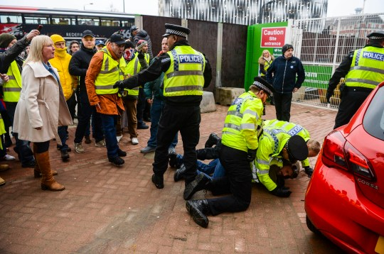 Police Officers arrest a Brexit supporting protester during a Brexit supporting 'Yellow Vest' protest through Leeds city centre this afternoon. The protest saw over 5 arrests by the police as roads were blocked off and traffic brought to a standstill. A counter protest from the Anti Fascist Leeds group also took place in the city centre - 19th January 2019