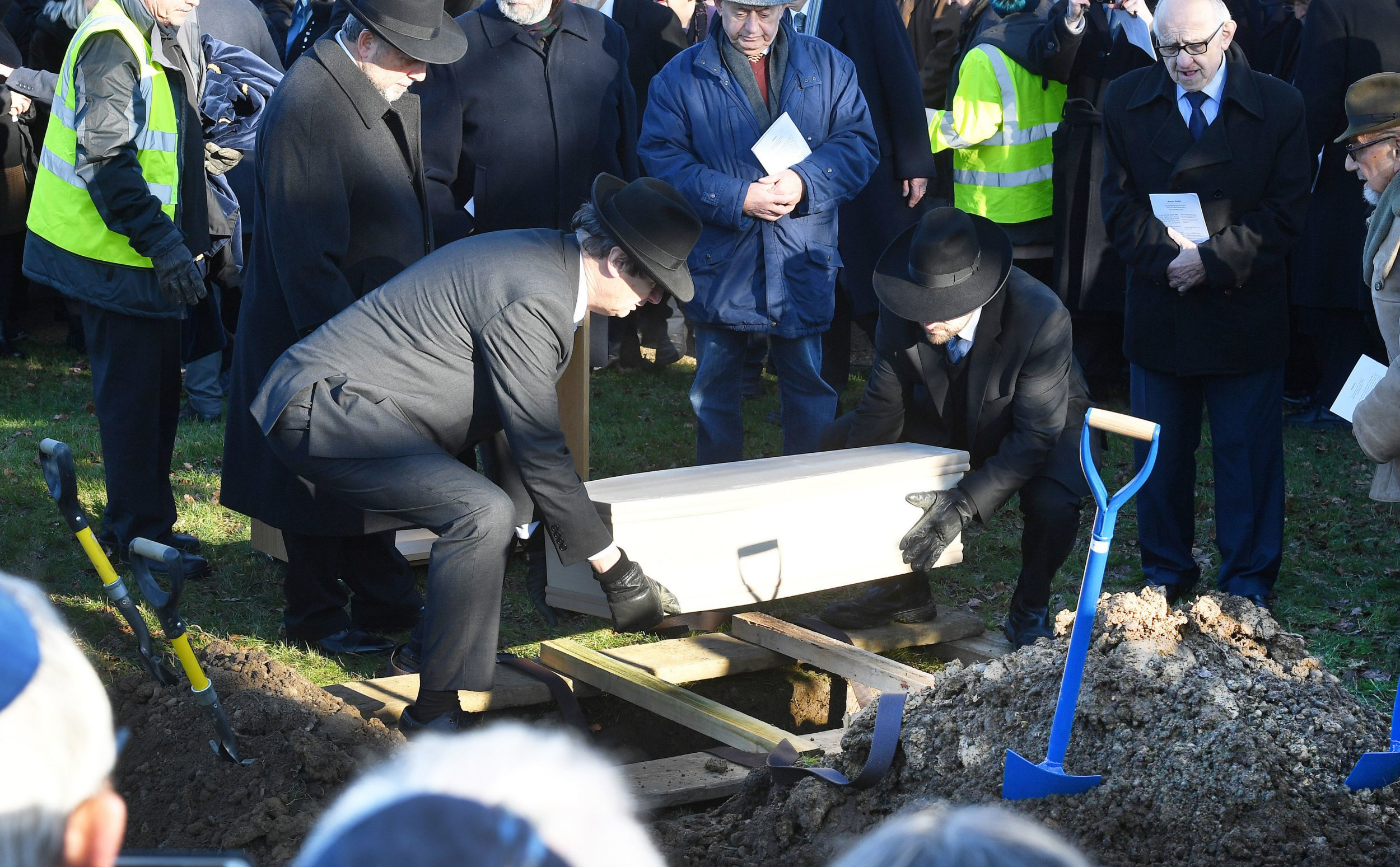 A coffin with the remains of six unknown Jews murdered at Auschwitz, is buried at the United Synagogue's New Cemetery in Bushey, Hertfordshire , after being in the Imperial War Museum for decades. PRESS ASSOCIATION Photo. Picture date: Sunday January 20, 2019. The remains of five adults and a child will be laid to rest after decades in the Imperial War Museum's archives. After a stocktaking of its Holocaust material last year, the museum decided that the ash remains should be returned to the Jewish community. See PA story FUNERAL Holocaust. Photo credit should read: John Stillwell/PA Wire