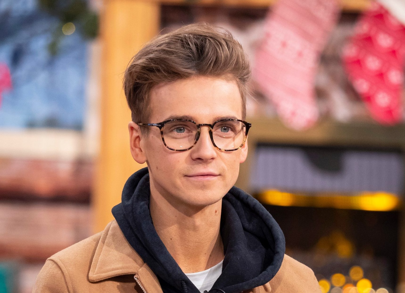 Joe Sugg wearing glasses on This Morning