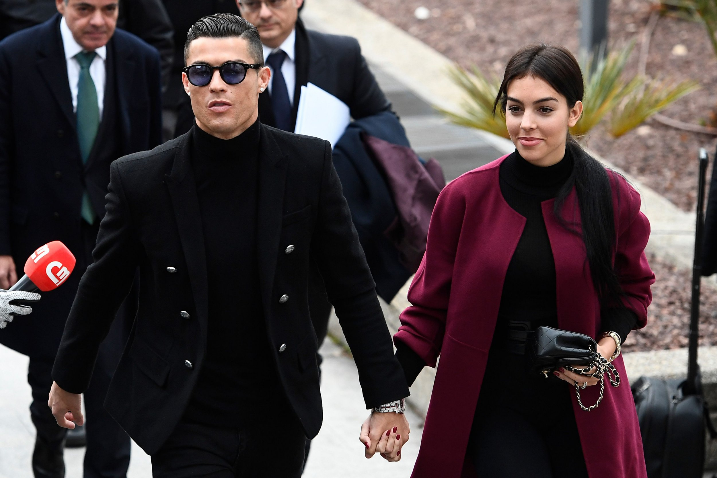 Juventus' forward and former Real Madrid player Cristiano Ronaldo arrives with his Spanish girlfriend Georgina Rodriguez to attend a court hearing for tax evasion in Madrid on January 22, 2019. - Ronaldo is expected to be given a hefty fine after Spanish tax authorities and the player's advisors made a deal to settle claims he hid income generated from image rights when he played for Real Madrid. (Photo by PIERRE-PHILIPPE MARCOU / AFP)PIERRE-PHILIPPE MARCOU/AFP/Getty Images