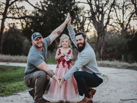 Dad and 'bonus dad' share cute picture with their daughter to show how blended families can work