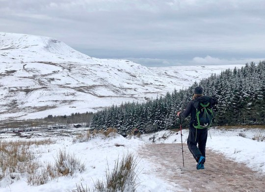 A walker in snow covered Brecon Beacons in Wales. PRESS ASSOCIATION Photo. Picture date: Wednesday January 23, 2019. See PA story WEATHER Cold. Photo credit should read: Claire Hayhurst/PA Wire