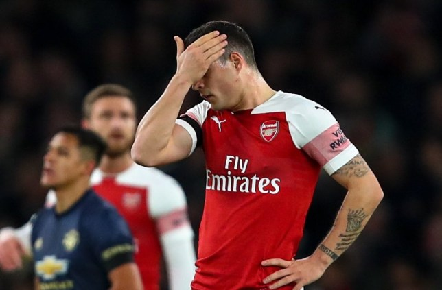 LONDON, ENGLAND - JANUARY 25: A dejected Granit Xhaka of Arsenal after conceding the first goal during the FA Cup Fourth Round match between Arsenal and Manchester United at Emirates Stadium on January 25, 2019 in London, United Kingdom. (Photo by Robbie Jay Barratt - AMA/Getty Images)