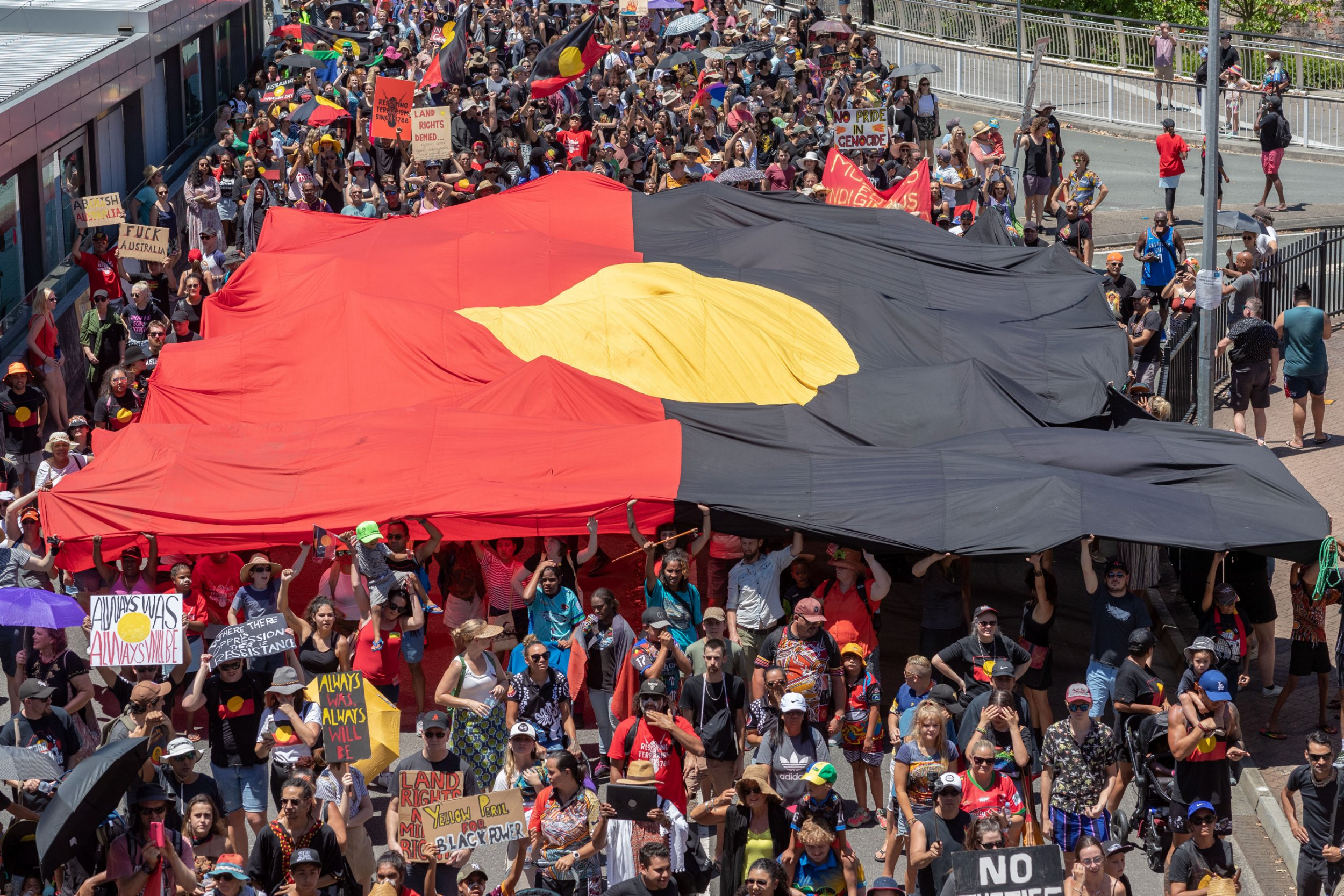 epa07320923 Invasion Day protesters are seen during the Australia Day celebrations in Brisbane, Queensland, Australia, 26 January 2019. Australia Day is the official national day of Australia, marking the anniversary of the First Fleet's arrival in Port Jackson, New South Wales on 26 January 1788. Some indigenous groups commemorate the 26 January as the invasion of their land by Europeans. EPA/GLENN HUNT AUSTRALIA AND NEW ZEALAND OUT
