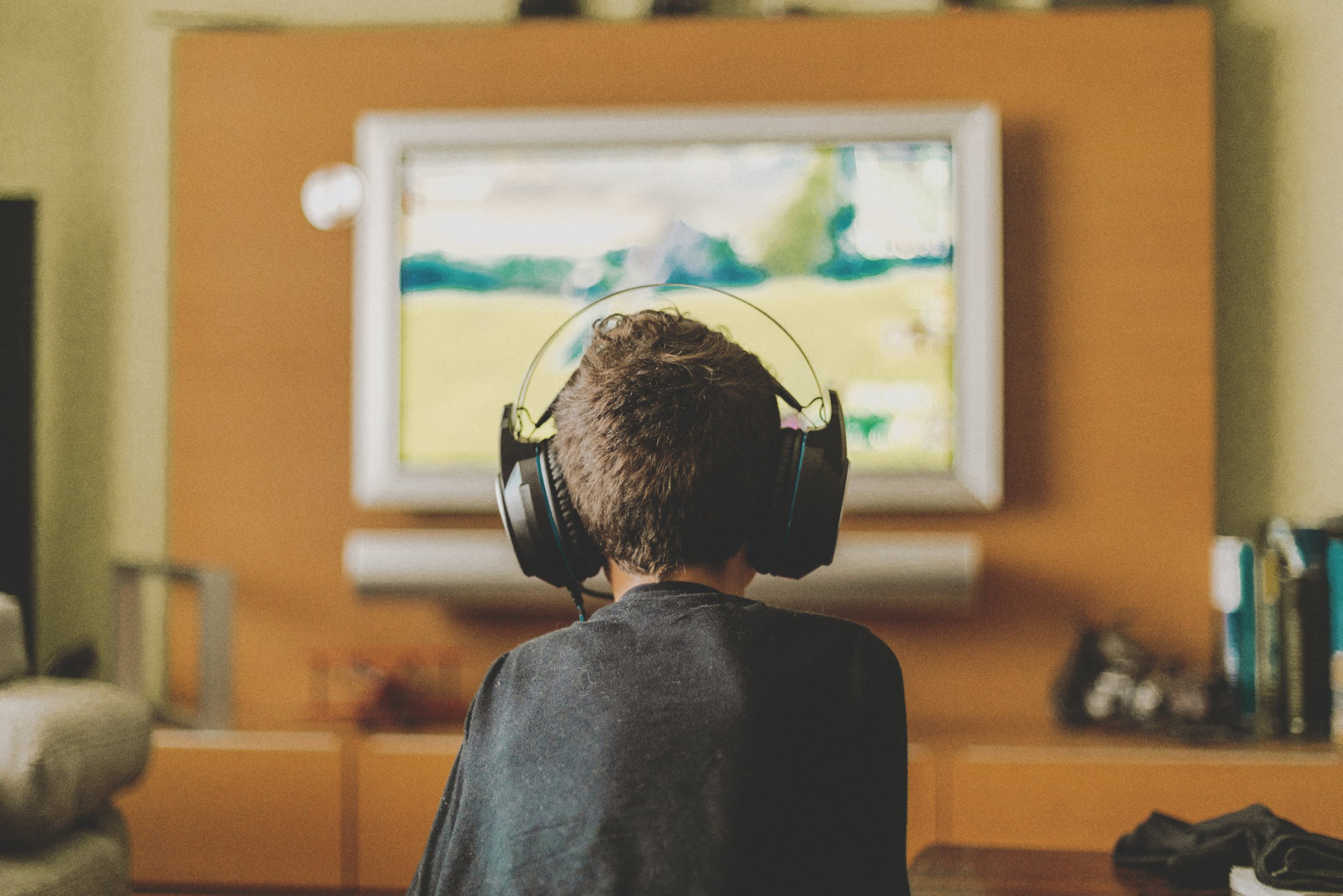 boy enjoying game console at home.Natural light