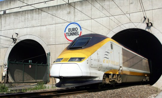 """An Eurostar train emerges from the Eurotunnel, 13 July 2006 in Coquelles, northern France. Eurotunnel was to """"place itself under the protection of the Paris Tribunal of Commerce"""" after a failure in negotiations on its debt with its creditors, a Eurotunnel spokesman announced today. AFP PHOTO DENIS CHARLET (Photo credit should read DENIS CHARLET/AFP/Getty Images)"""